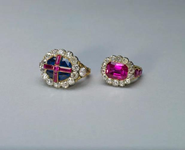The Queen's Ring (right) next to The Sovereign's Ring (left).