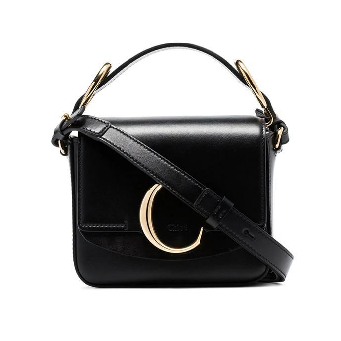 "Bag by Chloé, $1,954 at [Farfetch](https://www.farfetch.com/au/shopping/women/chloe-black-c-ring-top-handle-leather-shoulder-bag-item-13536703.aspx|target=""_blank""|rel=""nofollow"")."