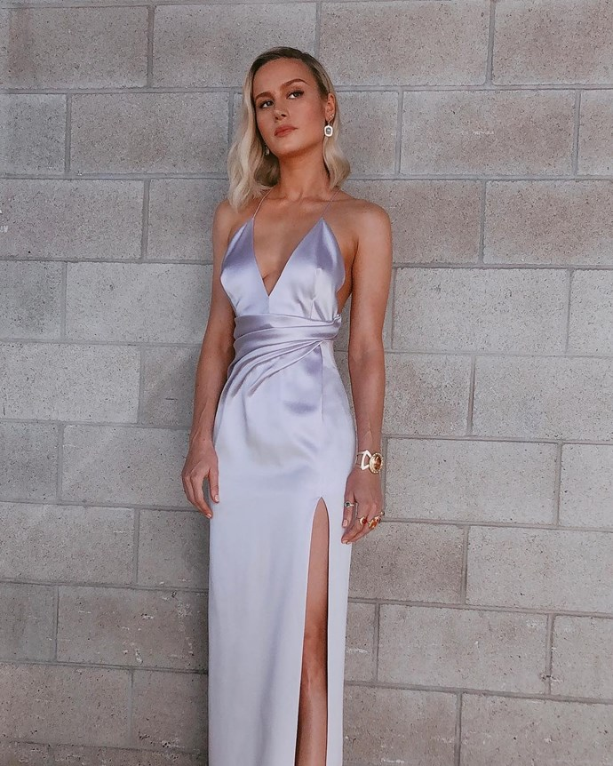 At the world premiere of *Avengers: End Game*, Larson donned a lilac Celine gown, which featured thin straps, a thigh-high split and a folded bodice. But her best accessory was a nod to the film's main villain, Thanos and his world-ending gauntlet.