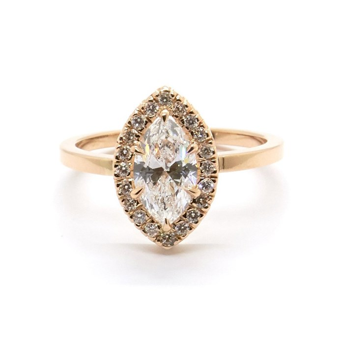 """Marquise halo ring in rose gold, $11,840 at [Natalie Marie Jewellery](https://www.nataliemariejewellery.com/collections/engagement-rings/products/marquise-halo-diamonds