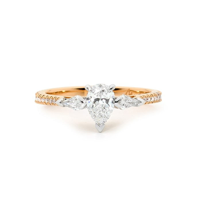 """Diamond and rose gold ring, POA at [Matthew Ely](http://www.matthewely.com.au/products/rose-gold-engagement-ring-with-pear-and-kite-shape-diamonds/6330/?terms=40