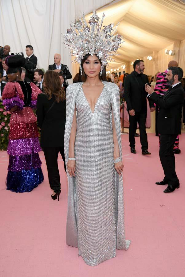 "**Gemma Chan in Tom Ford** <br><br> ""Wearing the halo and cape she so deserves, Gemma Chan's bedazzled Tom Ford gown is a lesson in audacious elegance. The simple bracelets keep the look cohesive, not cluttered."" - Kate Lancaster, beauty writer"