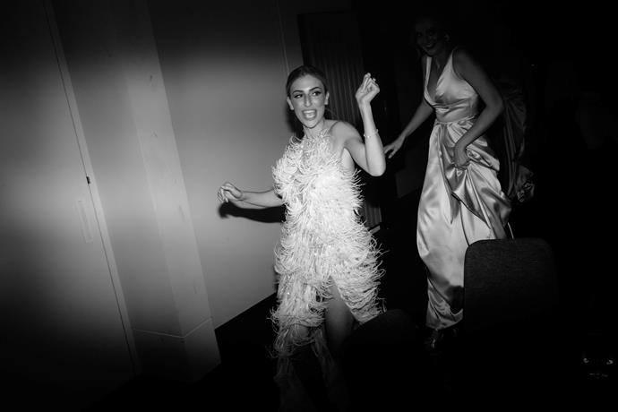 **Was there an outfit change for the reception?** There was an outfit change for both Tom and I. Tom changed into a white Tom Ford Tuxedo jacket and as soon as the dancefloor started to heat up I changed into a white halter neck ostrich feather gown also made by Alin Le'Kal.