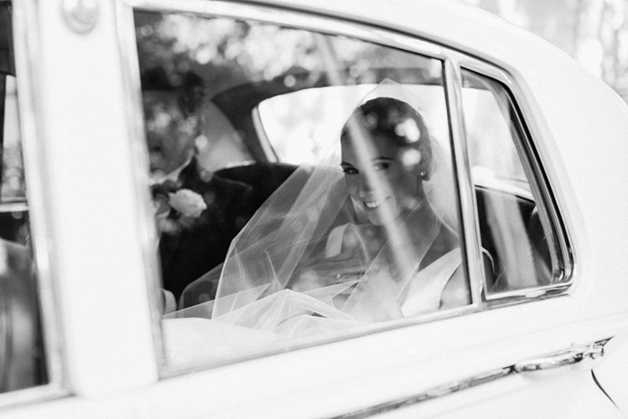 ***On her arrival and exit from the ceremony:*** In a vintage white Rolls Royce. The bridesmaids and groomsmen were in a Chrysler Limousine.