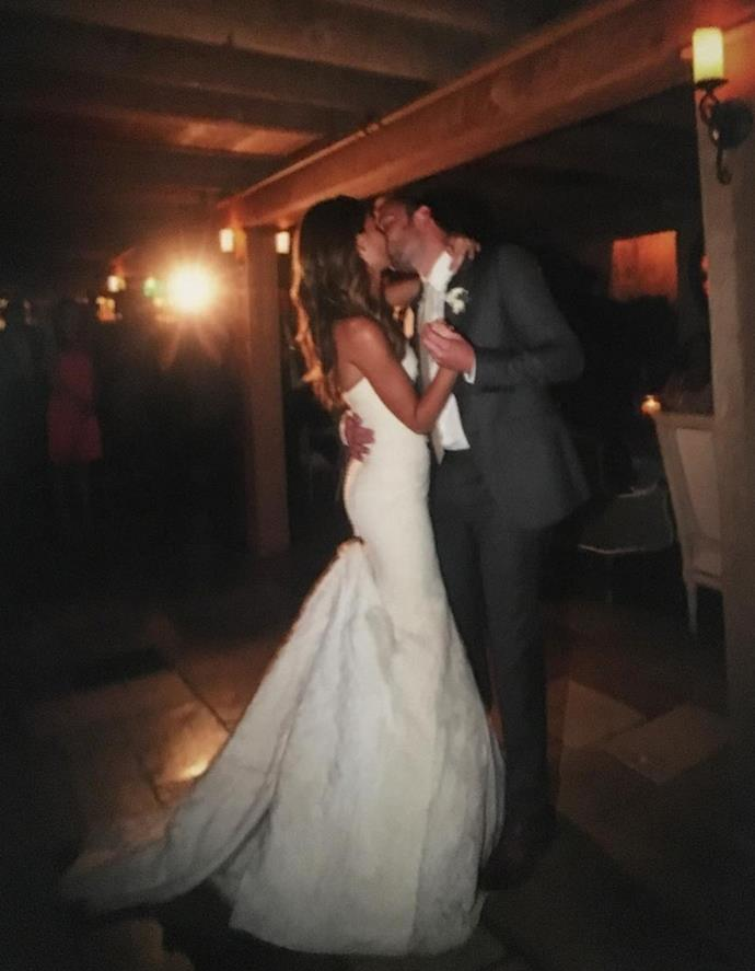 The couple share a kiss on their wedding night.
