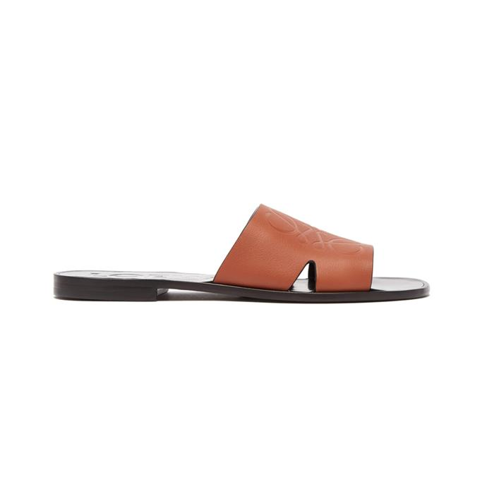 """***Comfortable sandals***<br><br> Traipsing around a foreign city is fun, but blisters aren't. A great pair of leather slip-on sandals will serve you and your arches well.<br><br> Sandals by Loewe, $592 at [MATCHESFASHION.COM](https://www.matchesfashion.com/products/Loewe-Anagram-embossed-leather-slides-1244113