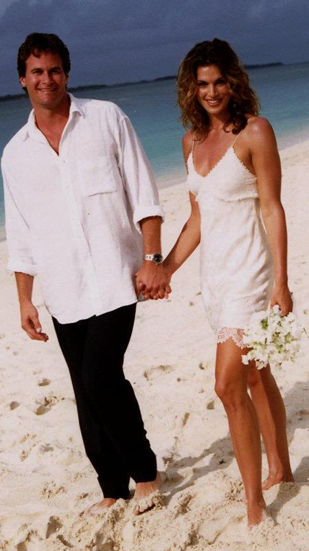 **Cindy Crawford:** For her beach ceremony with husband Rande Gerber in 1998, the supermodel wore a simple mini slip dress.