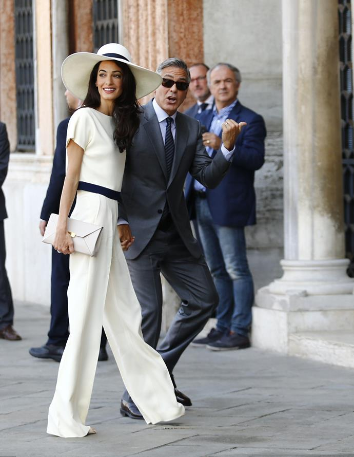 **Amal Clooney:** For her courthouse marriage to George Clooney, Amal channelled Bianca Jagger and donned an effortlessly chic Stella McCartney outfit with matching hat.