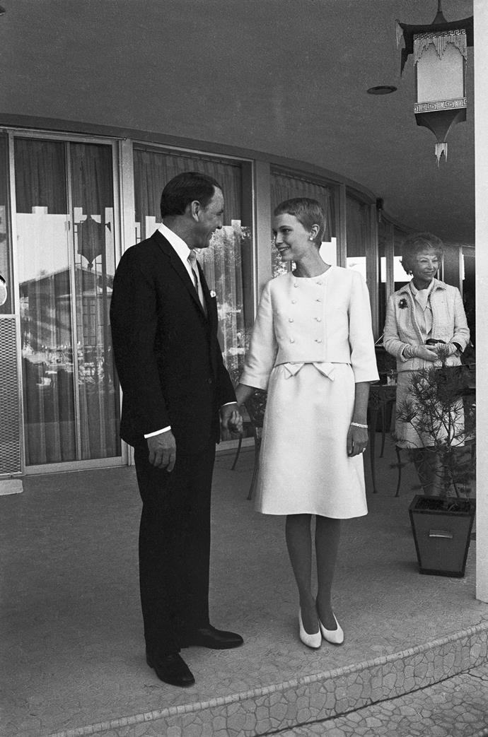 **Mia Farrow:** When Farrow married Frank Sinatra in Las Vegas in 1966, it was while wearing a pink faille sheath dress with a matching jacket boasting rhinestone buttons.