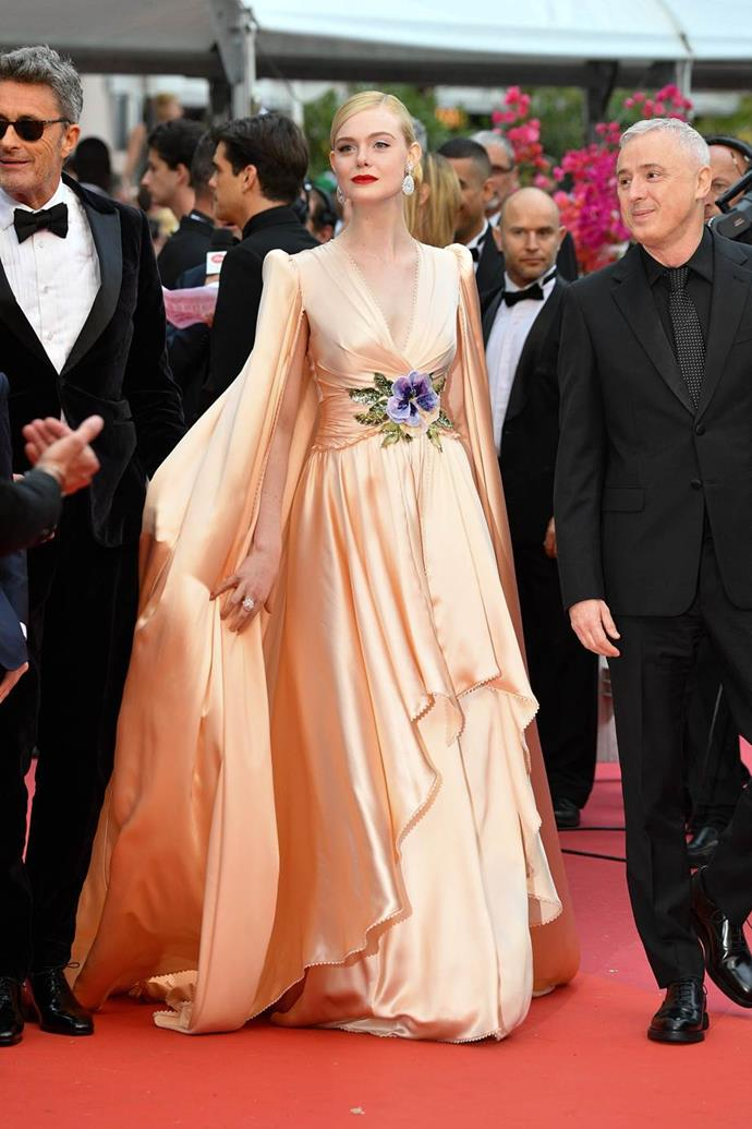 "***Elle Fanning in Gucci***<br><br> ""Elle Fanning had a stellar run of looks at Cannes—and offered a real return to expressive, individual dressing with her *My Fair Lady* Dior moment. My personal favourite was her tangerine dream Gucci gown for opening night—it was maximalist Hollywood glamour at its best—elevated tenfold by the elegant beauty look."" Grace O'Neill, fashion features director."