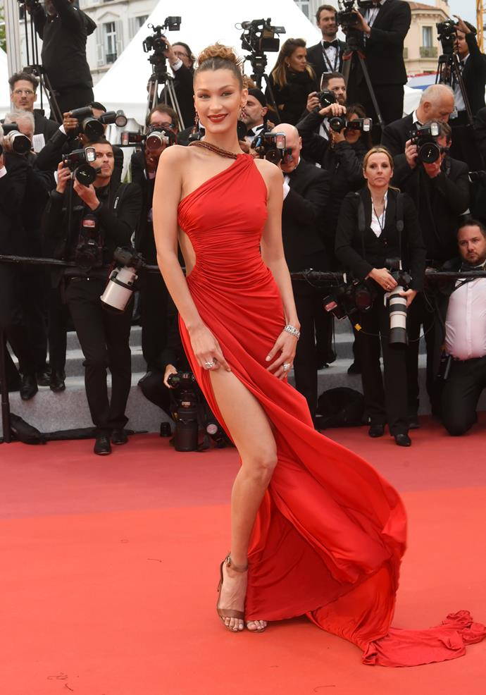 "***Bella Hadid in vintage Roberto Cavalli***<br><br> ""'Rouge ruching' might sound strange when you say it aloud, but it clearly works in a sartorial sense. Love the one shoulder neckline and the side cut-out, which feels sexy without  moving too far into 'Grammys' territory."" Kate Lancaster, beauty writer."