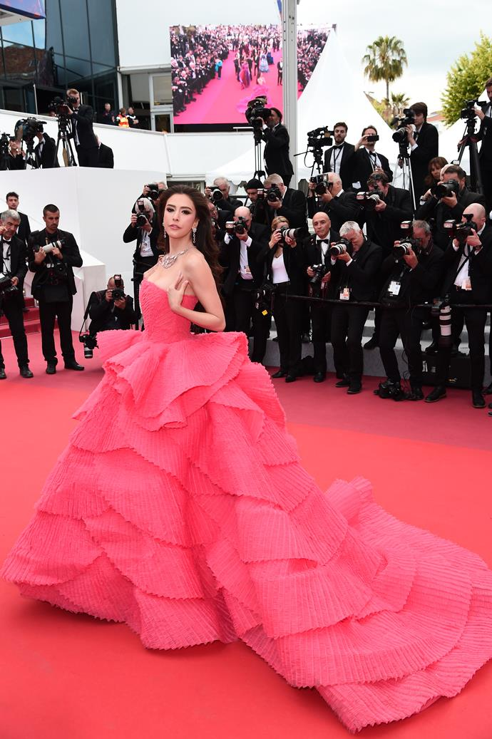 "***Sririta Jensen in Michael Cinco Couture***<br><br> ""There's nothing like a voluminous pink dress to make a statement at Cannes. Kendall Jenner wore a tulle iteration for amfAR gala, but the soft rose colour and sculptural shape of Sririta Jensen's pleated ruffle gown offers an elegant take on more-is-more."" Kate Lancaster, beauty writer."