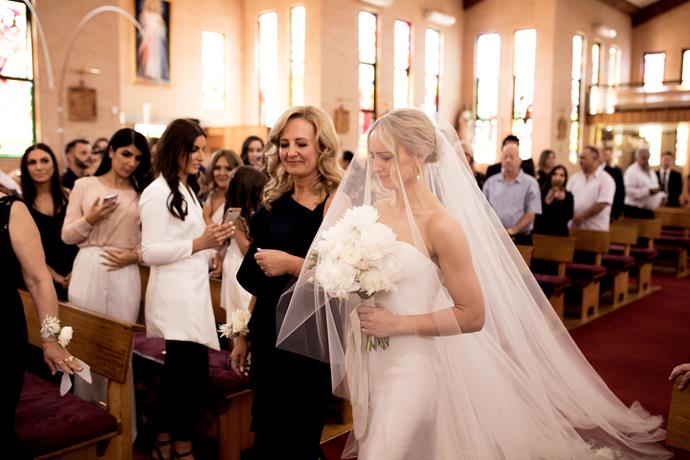 **On her arrival to the ceremony:** My mother walked me down the aisle while 'To Build a Home' by The Cinematic Orchestra played, which will forever be one of my favourite moments of the day.