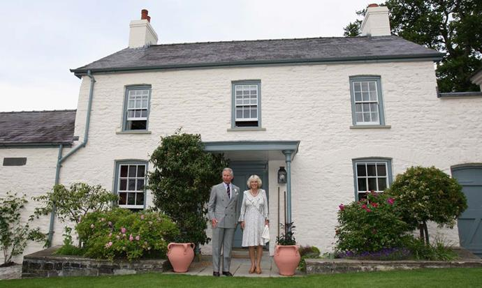 **The Property:** Llwynywermod.<br><br> **The Location:** Myddfai, Llandovery, Carmarthenshire, Wales.<br><br> **The History:** Originally owned by a relative of Anne Boleyn, the quaint three-bedroom house serves as one of the residences for Prince Charles when he's in Wales. When he's not staying there, it's often leased out as a bed and breakfast.<br><br> **Who Lives There:** The Prince of Wales and the Duchess of Cornwall.