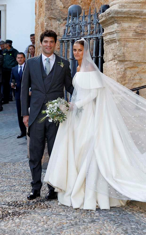 **Lady Charlotte Wellesley and Alejandro Santo Domingo**<br><br> For her 2016 wedding, Lady Charlotte Wellesley (daughter of the Duke of Wellington) wed in a relaxed affair in Spain. The bride wore off-the-shoulder Emilia Wickstead and hosted a dinner for close friends afterwards.