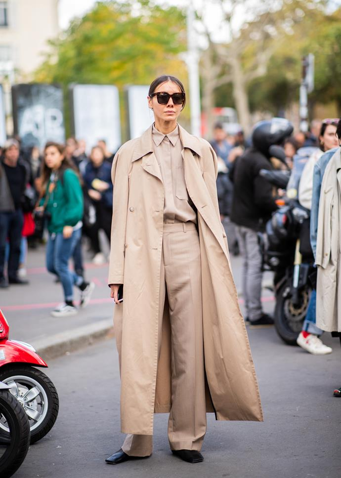 **An oversized trench or camel coat**