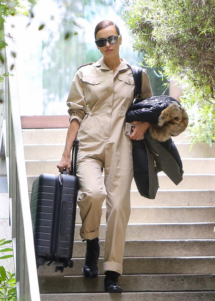 In a beige boilersuit and combat boots.