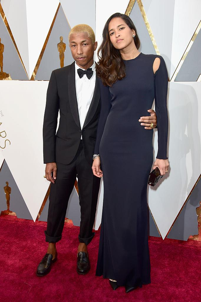 **Pharrell and Helen Lasichanh** <br><br> Pharrell's wife of six years is equally as cool as him, but almost a foot taller.