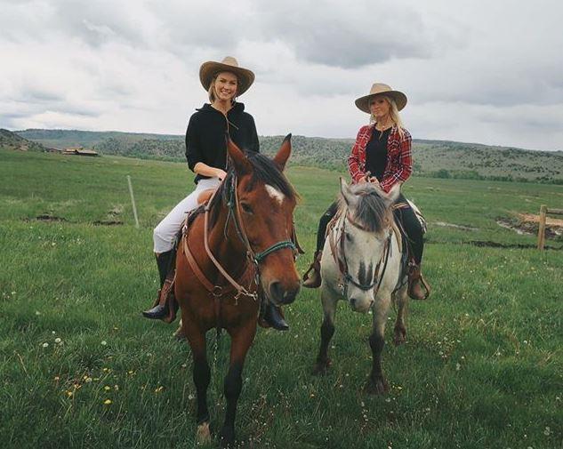 Karlie Kloss and a friend.