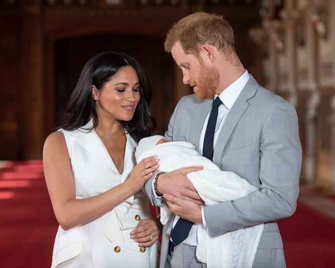 Meghan (wearing the updated ring) with Prince Harry and son Archie in May 2018.