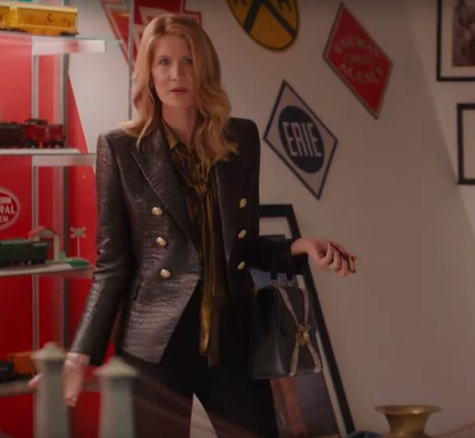 ***Renata's Gucci and Balmain ensemble: Episode three*** <br><br>  Later in episode three, Renata wreaked havoc around Monterey (and had an awkward encounter with Mary Louise) while wearing a Gucci logo belt and handbag, paired with a $3,000 tailored Balmain blazer in crocodile print worn over a gold blouse. Maximalism at its peak. <br><br> *Image: HBO*