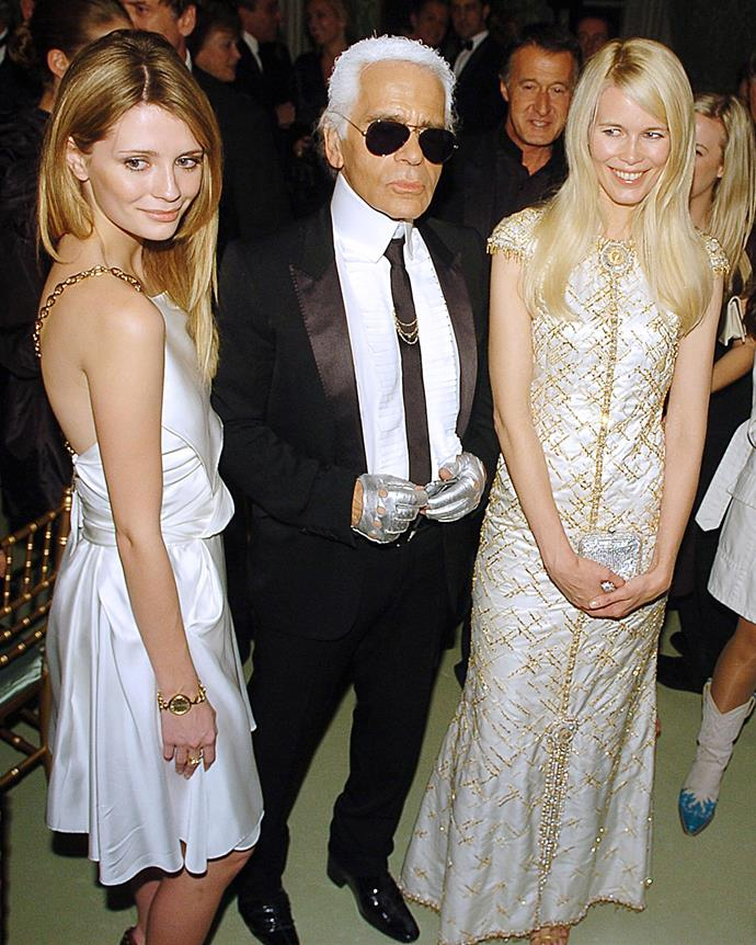 In Chanel in 2006, with Karl Lagerfeld and supermodel Claudia Schiffer.