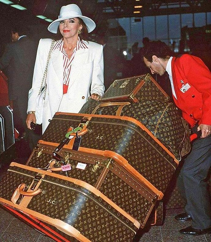 Joan Collins and her monogrammed Louis Vuitton luggage.