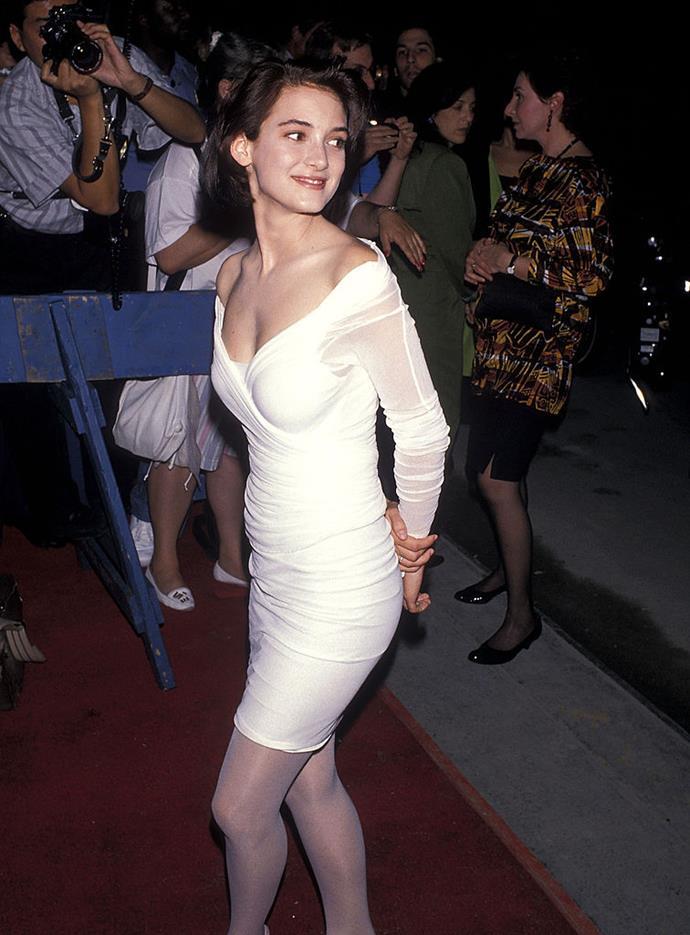In a mesh-sleeved white mini-dress in 1989.