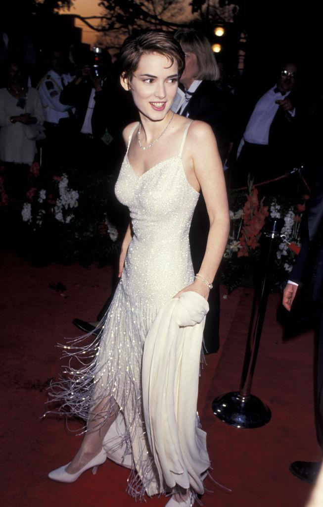 In her now-iconic beaded frilled dress at the 1994 Academy Awards.
