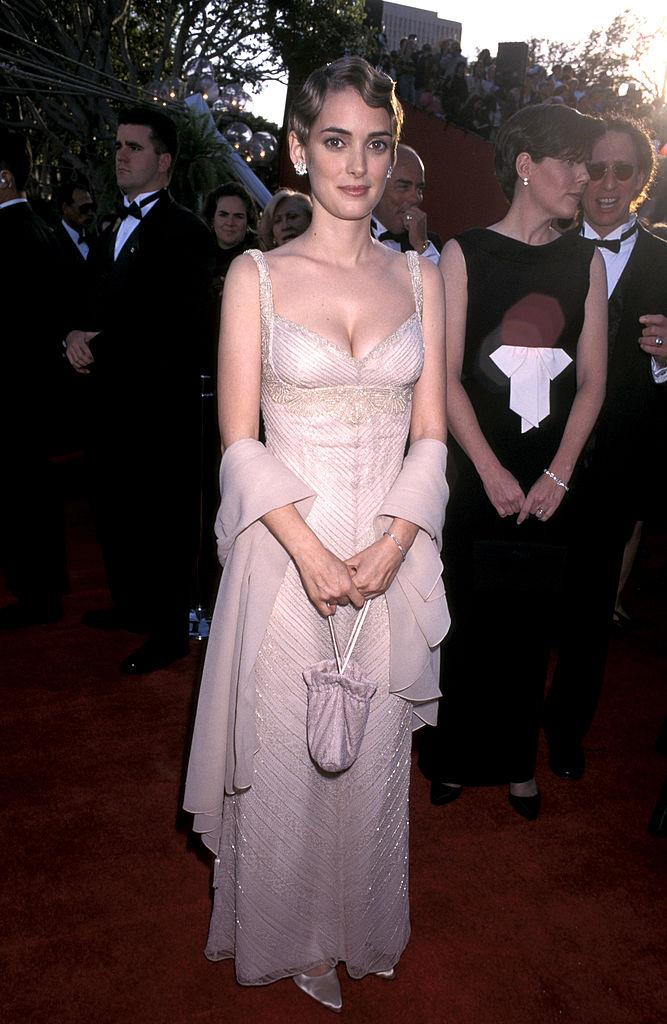 In a Badgley Mischka nude dress at the 1996 Academy Awards.