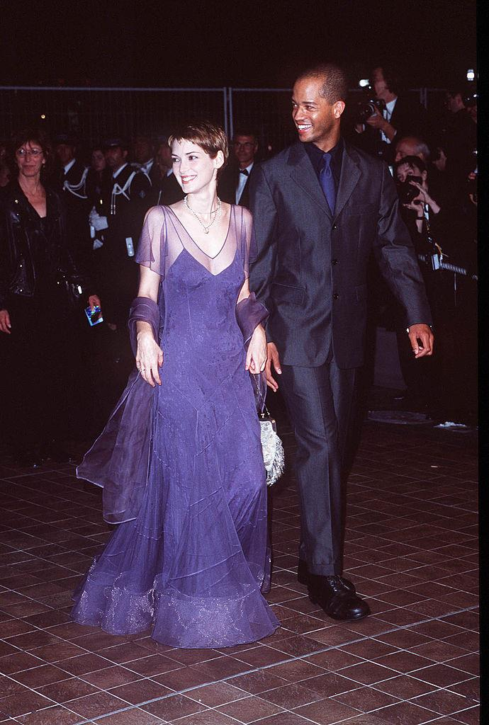 In a purple slip dress with sheer overlay at the Cannes Film Festival in 1998.