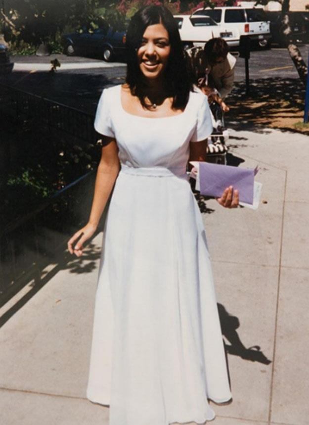 """**Kourtney Kardashian** <br><br> Kourtney Kardashian's prom look was the embodiment of '90s simplicity. One thing you can't see, however, are her [Gucci by Tom Ford](https://www.harpersbazaar.com.au/fashion/tom-ford-birthday-gucci-17236