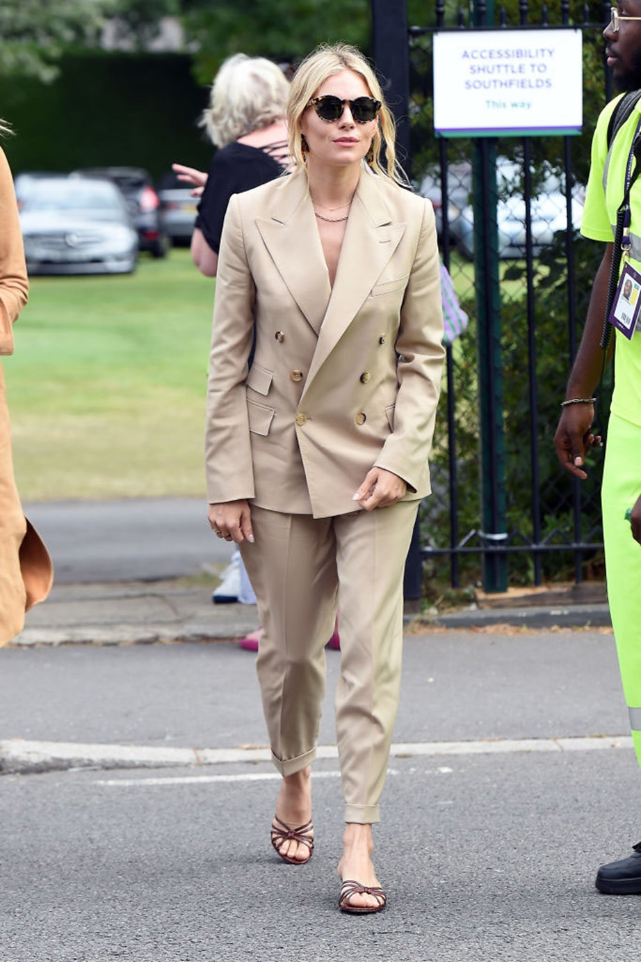 """***Sienna Miller***<br><br> """"Like everyone else, Sienna Miller got the memo that if you don't have round tortoiseshell sunnies, you're not getting into Wimbledon this year. But the double-breasted suit is a surprise ace."""" - Tom Lazarus, copy director.<br><br> """"Sienna Miller looks great in a tan suit! So effortless."""" - Grace O'Neill, fashion features director."""