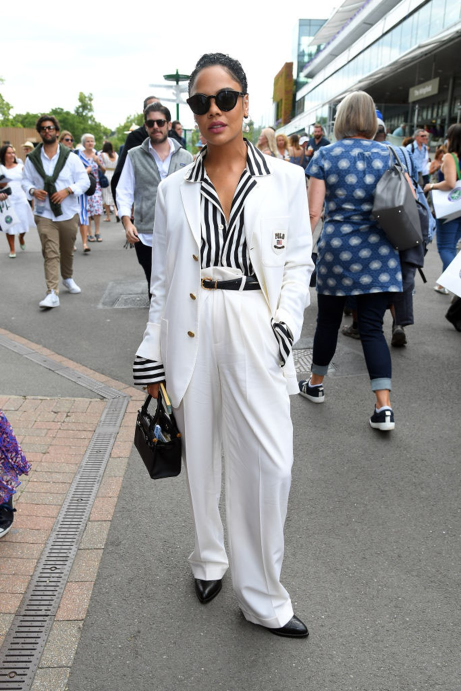 """***Tessa Thompson***<br><br> """"Love this. The pocket crest, the deckchair stripes, the puddle hems, the sheer audacity of those pants… it's Golden Age movie-studio honcho on a transatlantic ocean-liner champagne bender—in the best possible way."""" - Tom Lazarus, copy director.<br><br> """"Tessa is the epitome of cool in her oversized white suit and flats."""" - Grace O'Neill, fashion features director."""
