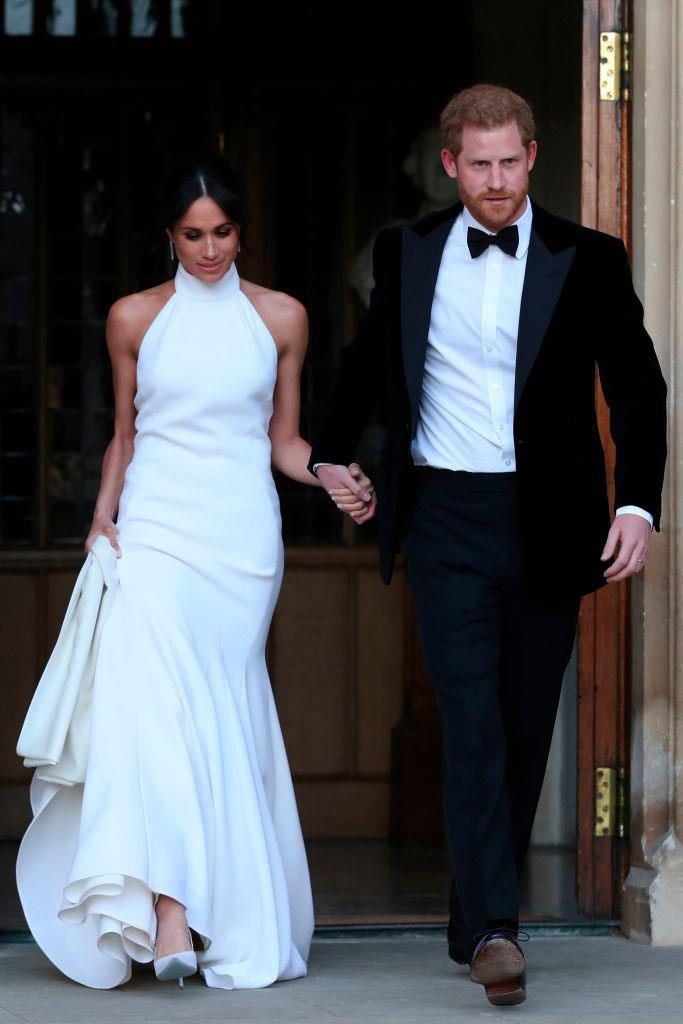 **SCORPIO: *Meghan Markle in Stella McCartney*** <br><br> Though much of the attention was understandably focused on her bespoke Givenchy gown, Duchess Meghan Markle's figure-hugging Stella McCartney reception dress was universally acclaimed. Scorpios are no stranger to sultry fashion choices, and a gown like this could make for an unconventional wedding day choice. <br><br> *Image: Getty*