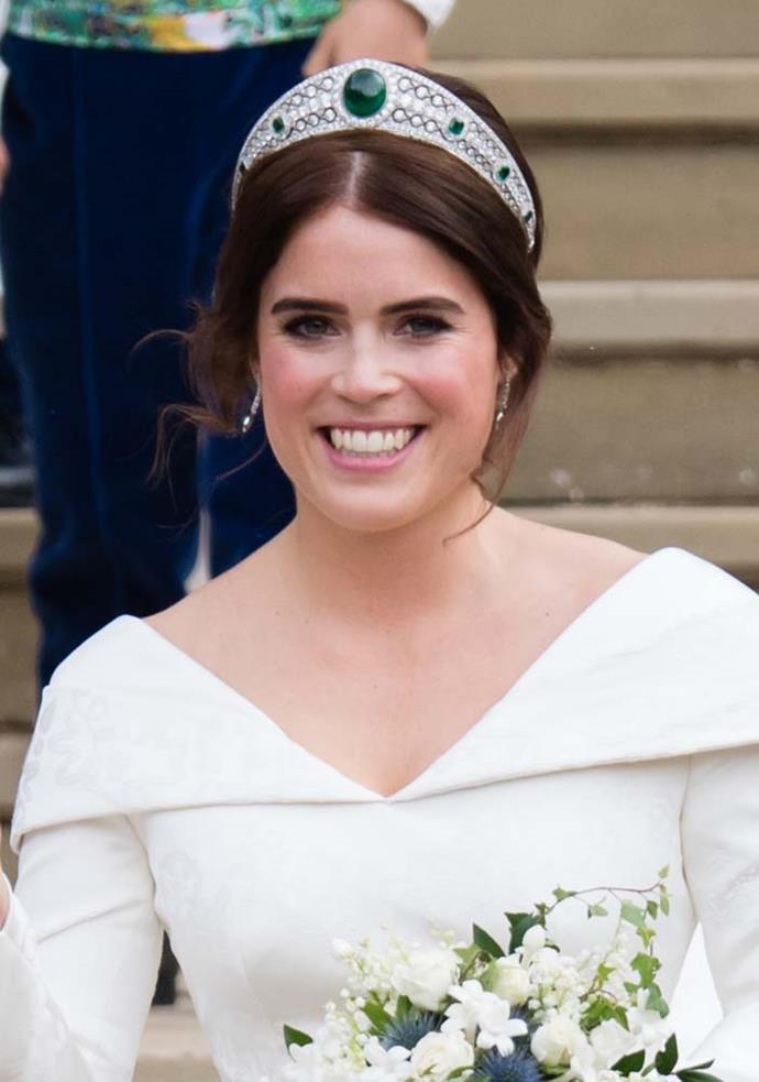 **The name:** The Greville Emerald Kokoshnik Tiara.<br><br> **The wearer:** Princess Eugenie of York.<br><br> **The history:** Made for the Hon. Mrs. Ronald Greville in 1912 by Boucheron, Mrs Greville gave the tiara to Elizabeth, the Queen Mother in 1942, although she never wore it. It consists of seven emeralds set amongst brilliant and rose-cut diamonds in a 'kokoshnik' style arc. The centre emerald weighs in at 93 carats.