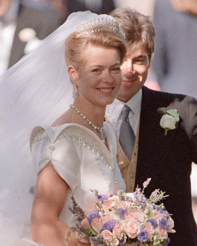 **The tiara:** The Kent Diamond and Pearl Fringe Tiara.<br><br> **The wearer:** Lady Helen Taylor.<br><br> **The history:** This tiara was originally owned by Queen Mary of Teck and features a distinctive 'comb' style of diamond spires, topped by pearls.