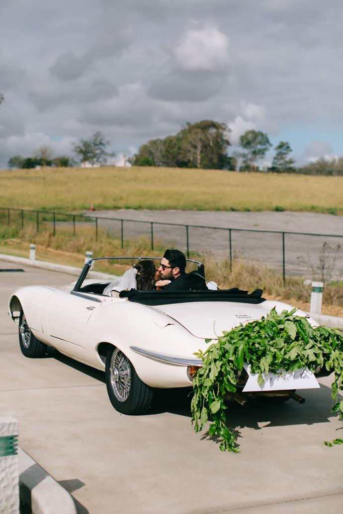 **On the most memorable moment of the day:** After the ceremony, we drove off in the Jaguar, just the two of us. We parked a few streets away from the church and just sat there, staring at each other so giddy and elated.