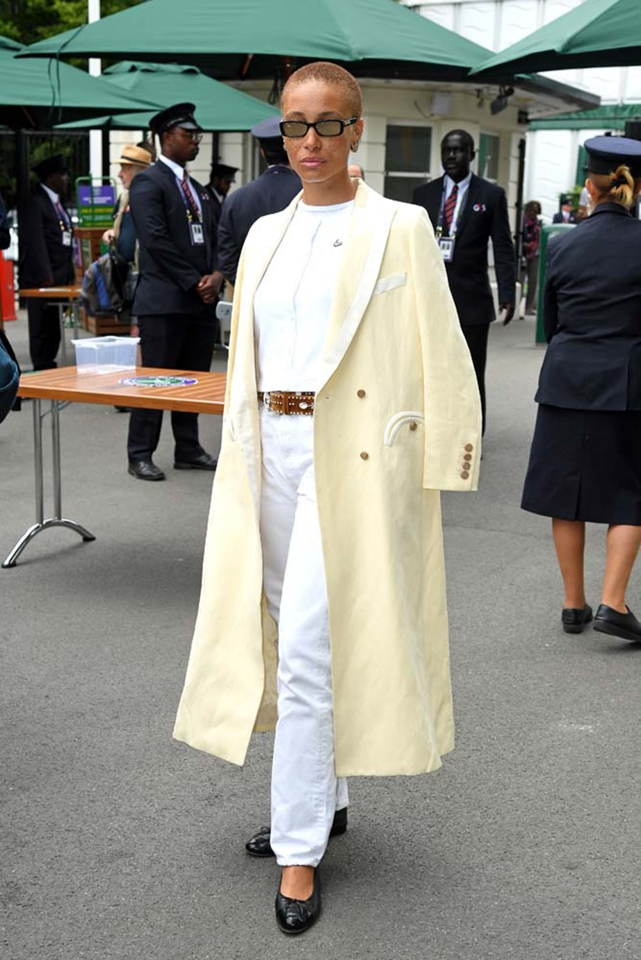 """***Adwoa Aboah***<br><br> """"Adwoa looks beautiful in her Blaze Milano coat. I love anyone who can pull off this shade of pale yellow. And the flat shoes are perfect for walking up all of those stairs."""" - Kate Sullivan, senior editorial coordinator. <br><Br> """"Tonal lemon dream chic. This Blaze Milano coat is heaven."""" - Caroline Tran, fashion editor."""