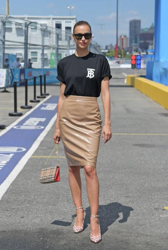 At the New York City E-Prix wearing Burberry.