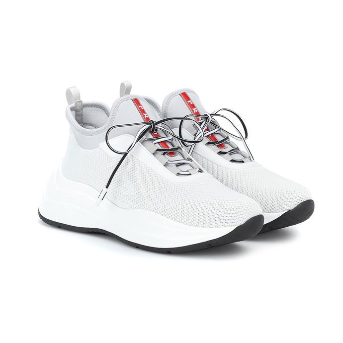 "**Buy:** Sneakers by Prada, $1,190 at [MyTheresa](https://www.mytheresa.com/en-au/prada-mesh-and-neoprene-sneakers-1128080.html?catref=category|target=""_blank""