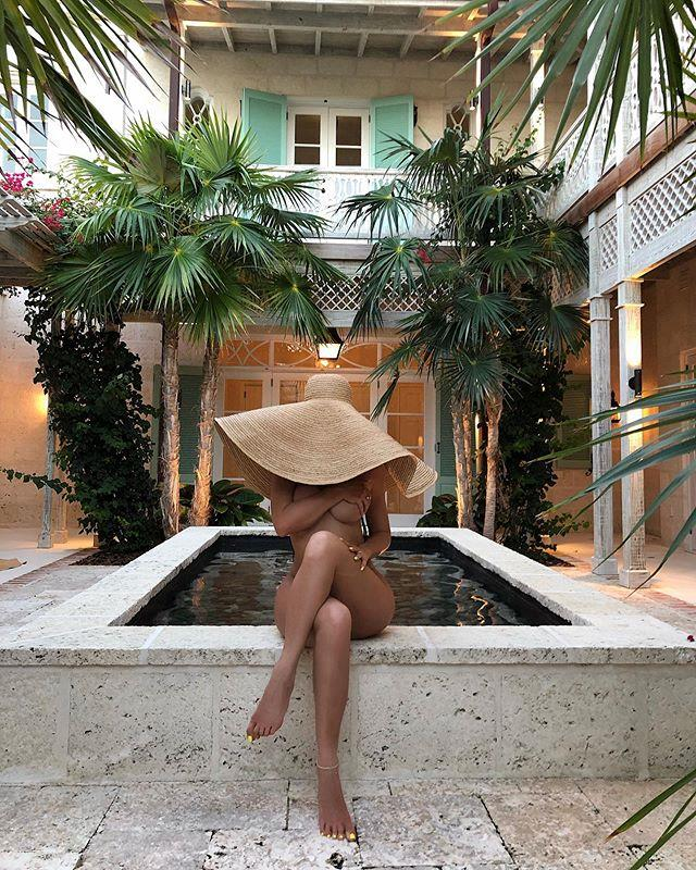 **Straw hat** <br><br> In one of her first posts from the trip, Jenner caused ripples with this artistic nude photo, wearing nothing but a wide-brim straw hat. Though the hat is similar to a style made by Jacquemus (one of Jenner and her sisters' favourite labels to wear), we're unsure of the actual make of Jenner's version. <br><br> ***Estimated cost: AU $440***