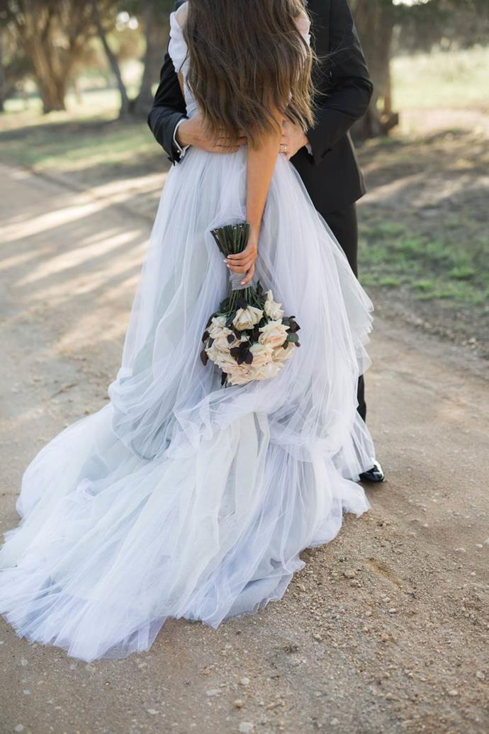 "Bek in Toni Maticevski. See more [here](https://www.harpersbazaar.com.au/bazaar-bride/blue-wedding-dress-inspiration-18017|target=""_blank"")."