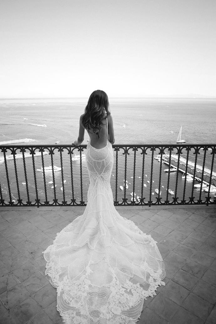 "Evah in MXM Couture. See more [here](https://www.harpersbazaar.com.au/bazaar-bride/hotel-convento-di-amalfi-wedding-18980|target=""_blank"")."