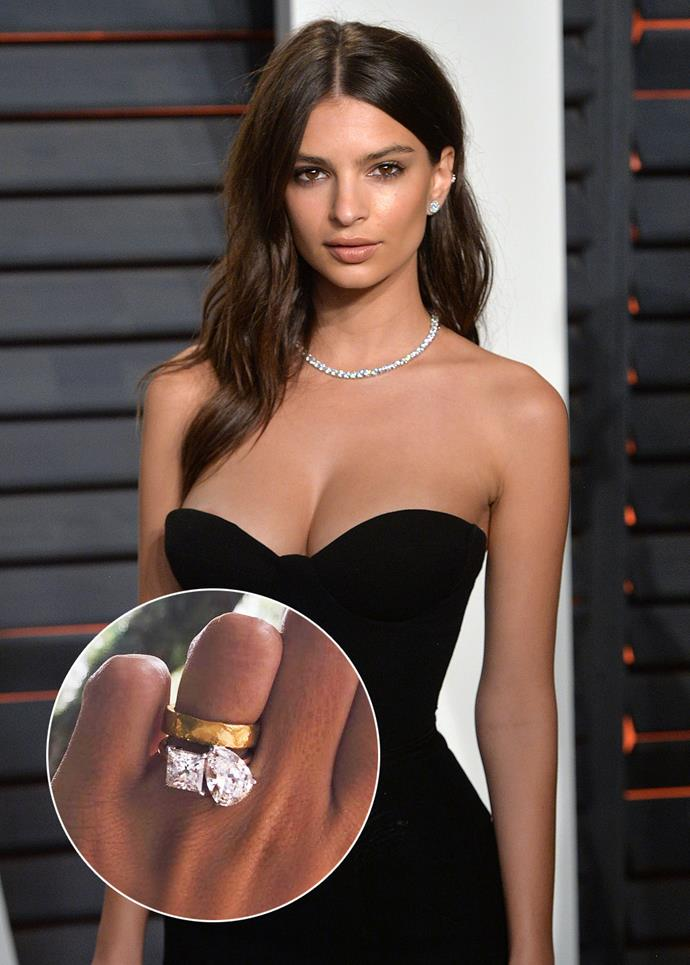 Emily Ratajkowski showed off her engagement ring which features two large diamonds, one square-cut and one pear-cut, side by side.