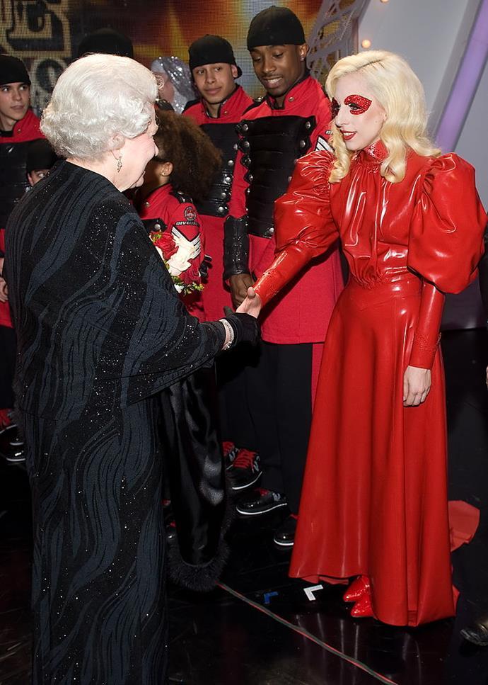 Lady Gaga meeting Queen Elizabeth II in 2009.
