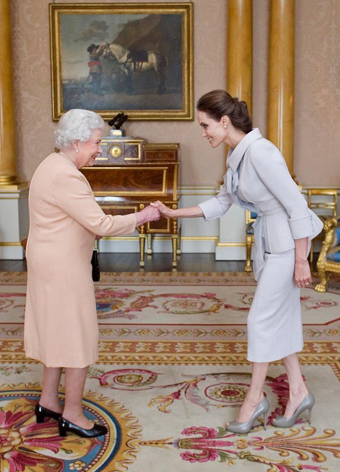 Angelina Jolie meeting Queen Elizabeth II in 2014.