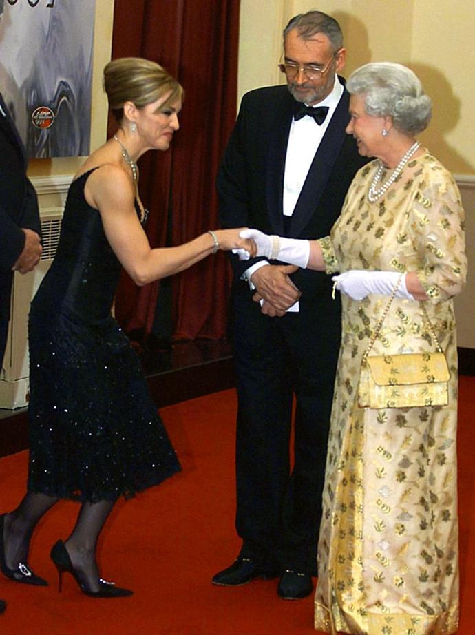 Madonna meeting Queen Elizabeth II in 2002.