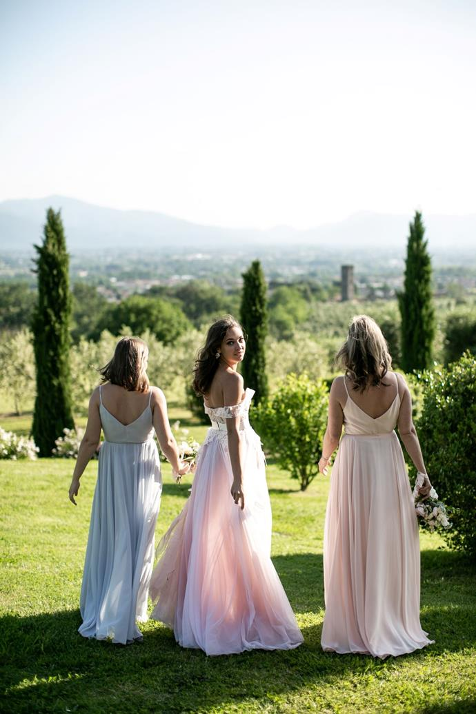 **On the bridesmaids' looks:** My bridesmaids are based in Toronto, so they did a few salon visits and dress hunting on their own to figure out what style made them feel beautiful and complimented their bodies. I gave them a choice of a couple of different colours. My maid of honour chose icy blue and my other bridesmaid opted for light peach. Together with my blush wedding gown, the dresses looked so magical and fit the perfect backdrops of Tuscany.