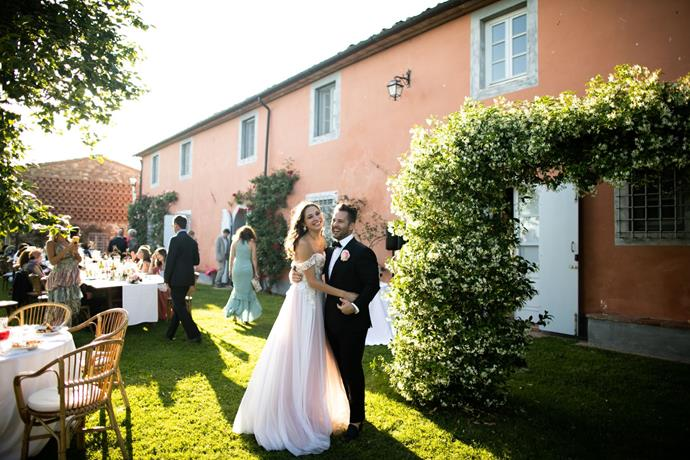 """**On the most memorable moment of the day:** Samuel—""""Right after the ceremony one of my groomsmen put an Aperol Spritz in my hand, our friends and family surrounded Ksenia and I and showered us with rose petals. It was such a fun surprise. So many hugs and kisses and love from our guests ushered us into the cocktail hour. Another favourite moment was watching Ksenia come down the aisle for our ceremony, I kept telling myself to hold it together and not start ugly crying, I held it together for the most part and soaked up every second of that moment seeing her coming down the aisle to me. My best men speeches from each of my brothers was such a highlight and makes me tear up just thinking back about it."""""""